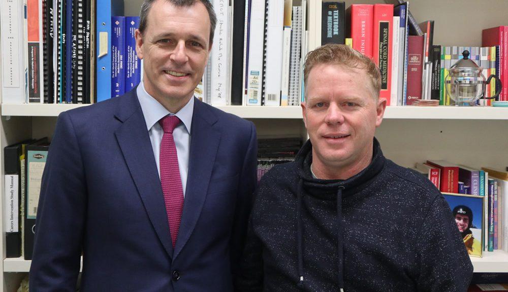 Dr Sean Nicklin with Jason